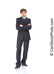 Portrait of a cheerful business man standing with hands at the side. Isolated on white background