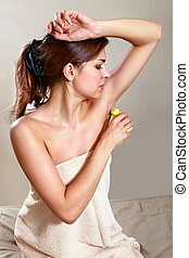 woman applying antiperspirant - beautiful woman applying...