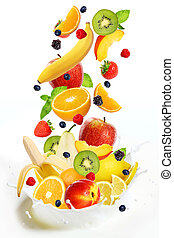 Lot of different fruits falling into milk - Different fresh...