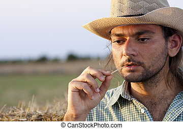 Farmer Thinking with Straw - Farmer Thinking at Sunset with...