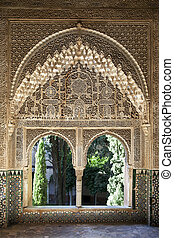 Alhambra windows - A view to the courtyard through arched...
