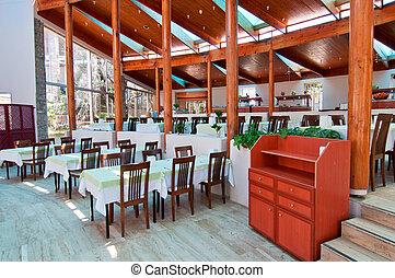 Empty restaurant awaiting visitors - Tables and chairs in a...