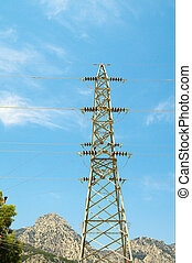 Electrical tower on a background of the clear blue sky