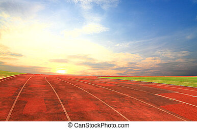 Running track with one lanes with sky sunset