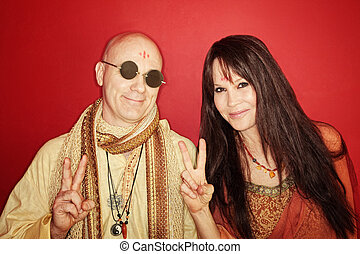 Hippies With Peace Sign - Smiling guru with woman gestures...
