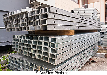 Metal girder in group tilted out - Pile of matal girder in...