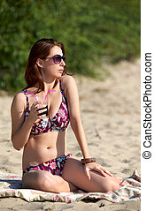 Young woman wearing sunglasses on the beach