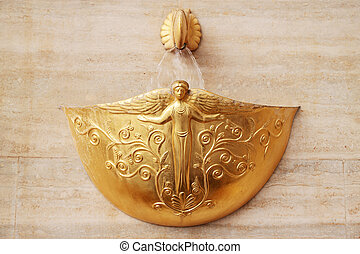 gold fountain - Decorative gold fountain for the wall in the...