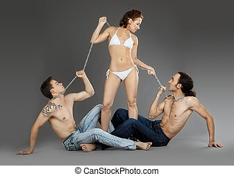 Two man on chain for woman - sexual games in slave position