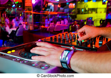 Dj mixes the track in the nightclub at a party - Dj playing...