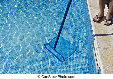 Cleaning pool - A men cleaning the pool and the water seams...