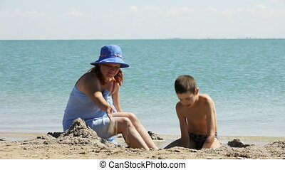 Joint efforts - Mother and son together dug a pit in the...