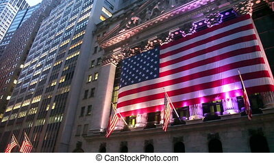 Iconic building of NYSE at dusk, pan
