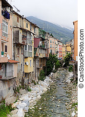 Carrara (Tuscany, Italy), old colorful buildings along the...