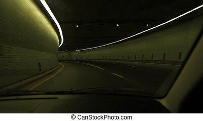 Green tunnel. - Driving through a tunnel lit with green...