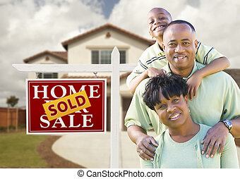 African American Family, House and Sold Sign - Happy African...