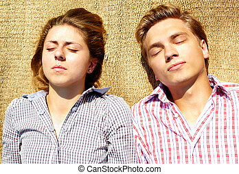 Slumber - Portrait of young couple having a nap