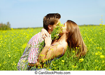Kiss in the field - Portrait of young romantic couple...