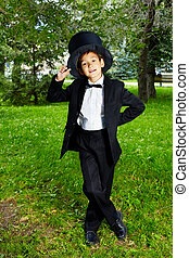 Boy in tux - Portrait of boy groom looking at camera in the...