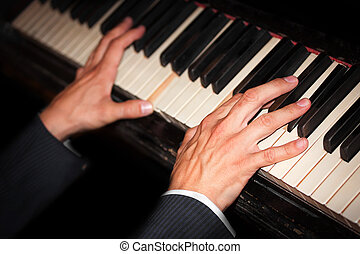 Live music - pianist hands on the piano keys