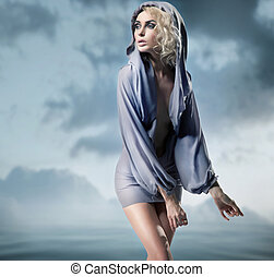Glamour woman posing over blue background