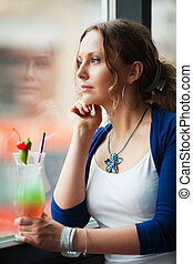 Young woman with a cocktail - Beautiful young woman with...