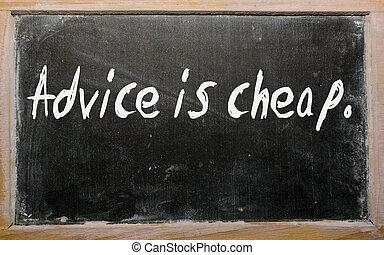 """""""Advice is cheap"""" written on a blackboard"""