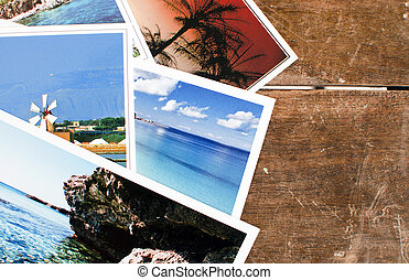 Postcards - Pile of postcards - or photos - over an old...