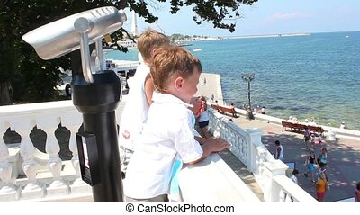 Children are watching at sea