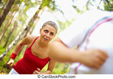 Running sprint - Image of happy young female running after...