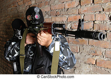 Sniper targeting on scope - Fully equipped military men with...