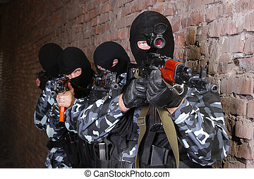 Group of soldiers in black masks with guns - Fully equipped...