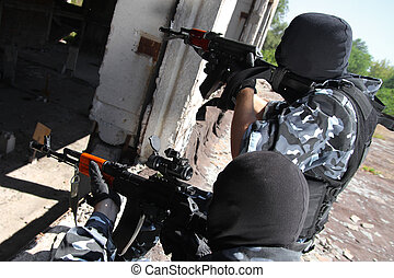 Two soldiers targeting with guns - Fully equipped military...