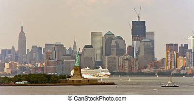 White Cruise Ship and Statue of Liberty - A white cruise...