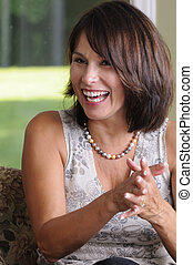 Happy Woman - Mature Woman Caught Laughing At A Party