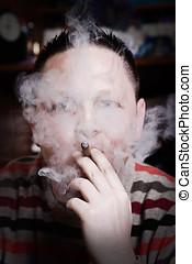 man smoking cigar - Close up portrait of man smoking cigar.