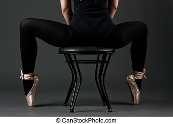 dancing woman - Dancing woman in ballet shoes sitting on the...