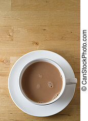 Cup of Tea on Wooden Table - Overhead shot of a cup of tea,...