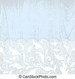 lace frame at blue wooden background