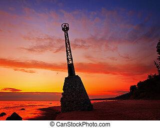 beacon on the seashore against the dusk