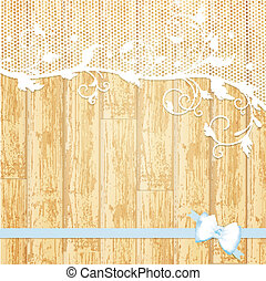 lace frame with blue bow at light wooden background