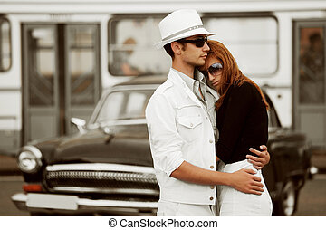 Young couple against a retro car