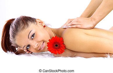 Portrait of a young woman being massaged
