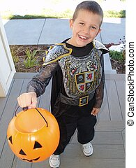 Trick or Treat - Little boy in a knight outfit trick or...