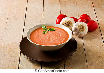 Tomato Soup - photo of delicious tomato cream soup on wooden...