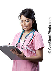 Asian Nurse writing on patient\'s chart