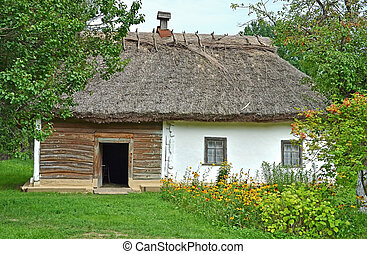 Ancient traditional ukrainian rural cottage with a straw...