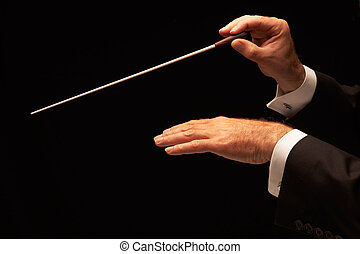 Conductor conducting an orchestra isolated on black...