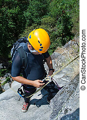 Men with rope for rappelling - Men prepering to rappeling on...
