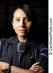 police officer - a female police officer posing for her...